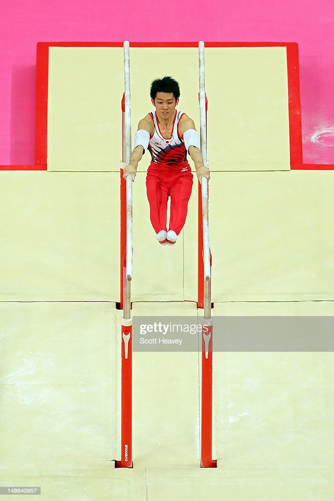 Kazuhito Tanaka of Japan competes in the Artistic Gymnastics Men's Parallel Bars final on Day 11 of the London 2012 Olympic Games at North Greenwich...