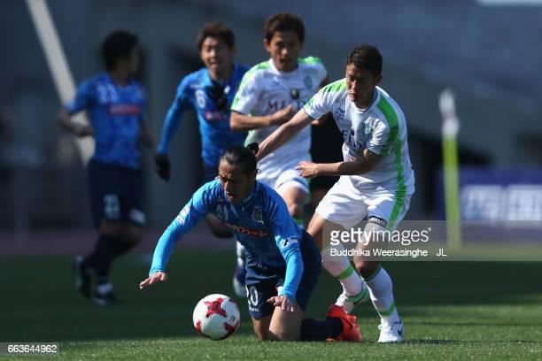 Kazuki Hara of Kamatamare Sanuki is challenged by Hiroki Akino of Shonan Bellmare during the JLeague J2 match between Kamatamare Sanuki and Shonan...