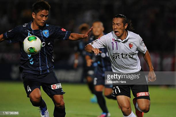 Kazuki Hara of Kyoto Sanga and Bae Seung Jin of Yokohama FC compete for the ball during the JLeague second division match between Yokohama FC and...