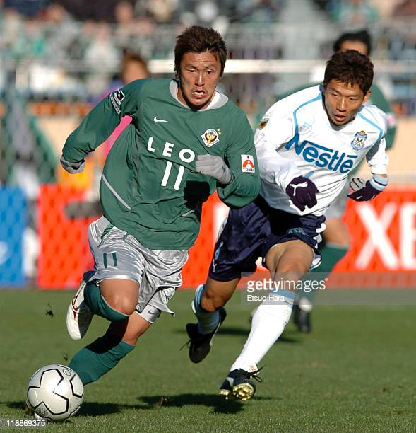 Kazuki Hiramoto of Tokyo Verdy 1969 and Toshihiro Hattori of Jubilo Iwata compete for the ball during the 84th Emperor's Cup final match between...