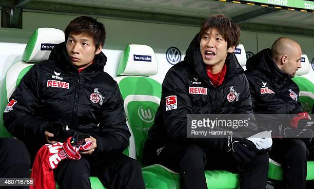 Kazuki Nagasawa and Yuya Osako of Koeln prior to the Bundesliga match between VfL Wolfsburg and 1 FC Koeln at Volkswagen Arena on December 20 2014 in...
