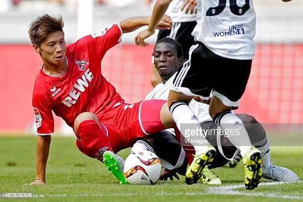 Kazuki Nagasawa of 1 FC Koln Ibrahim Diallo of Valencia CF during the Colonia Cup match between 1 FC Koln and Valencia on August 2 2015 at the...