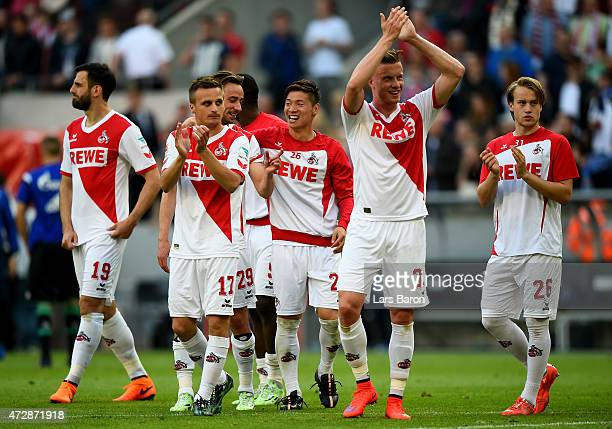 Kazuki Nagasawa of 1FC Koeln celebrates with team mates after winning the Bundesliga match between 1 FC Koeln and FC Schalke 04 at...