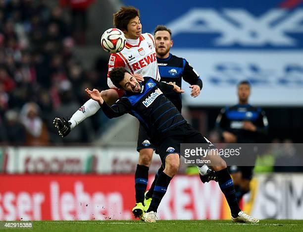 Kazuki Nagasawa of 1FC Koeln challenges Lukas Rupp of SC Paderborn during the Bundesliga match between 1 FC Koeln and SC Paderborn 07 at...