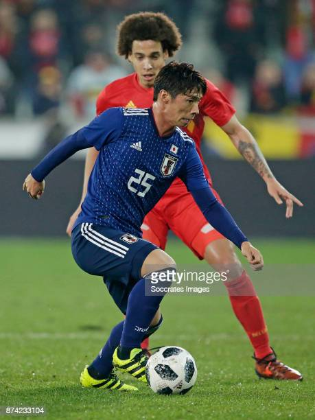 Kazuki Nagasawa of Japan Axel Witsel of Belgium during the International Friendly match between Belgium v Japan at the Jan Breydel Stadium on...
