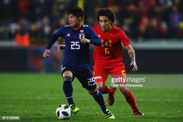 Kazuki Nagasawa of Japan battles for the ball with Axel Witsel of Belgium during the international friendly match between Belgium and Japan held at...