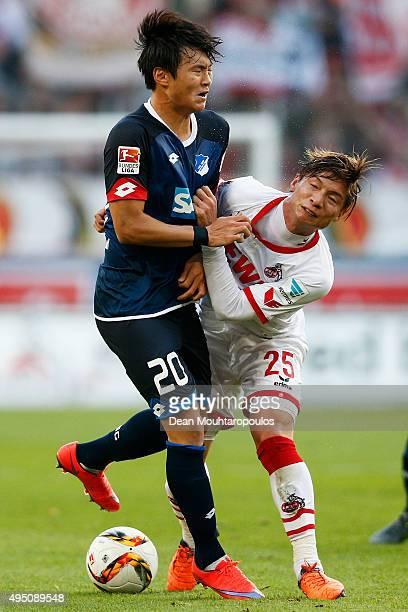 Kazuki Nagasawa of koeln battles for the ball with Kim Jinsu of Hoffenheim during the Bundesliga match between 1 FC Koeln and TSG 1899 Hoffenheim...