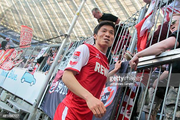 Kazuki Nagasawa of Koeln celebrates with fans after the Second Bundesliga match between TSV 1860 Muenchen and 1 FC Koeln at Allianz Arena on March 30...