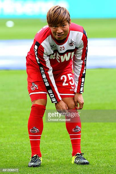 Kazuki Nagasawa of Koeln warms up prior to the Bundesliga match between FC Schalke 04 and 1 FC Koeln at VeltinsArena on October 4 2015 in...