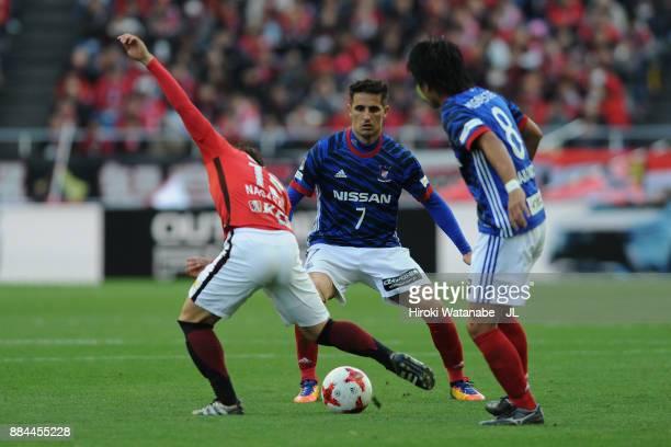 Kazuki Nagasawa of Urawa Red Diamonds and Hugo Vieira of Yokohama FMarinos compete for the ball during the JLeague J1 match between Urawa Red...
