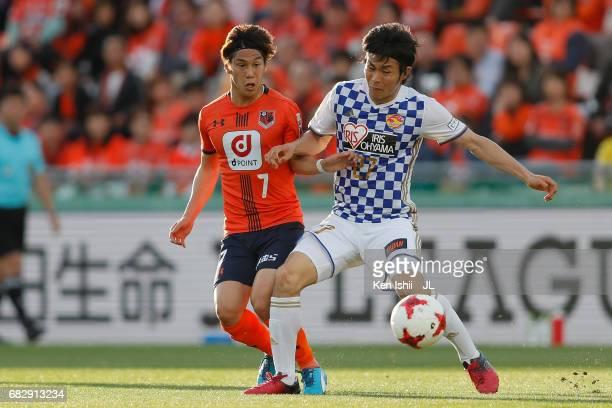 Kazuki Oiwa of Vegalta Sendai and Ataru Esaka of Omiya Ardija compete for the ball during the JLeague J1 match between Omiya Ardija and Vegalta...