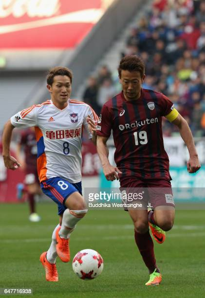 Kazuma Watanabe of Vissel Kobe and Kei Koizumi of Albirex Niigata compete for the ball during the JLeague J1 match between Vissel Kobe and Albirex...