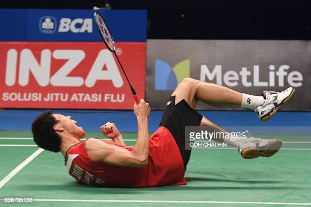 Kazumasa Sakai of Japan celebrates beating Prannoy HS of India in the men's singles semifinal match at the Indonesia Open badminton tournament in...