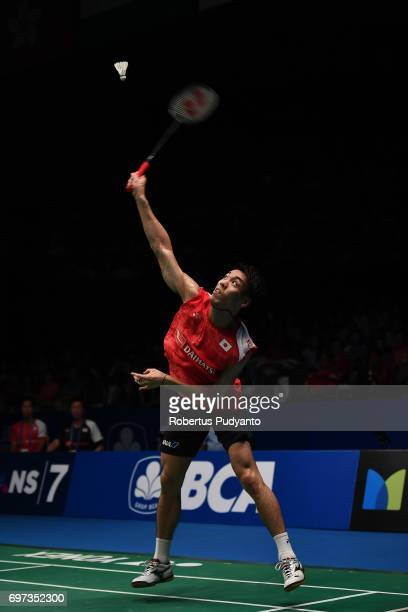 Kazumasa Sakai of Japan competes against Kidambi Srikanth of India during Men's Single Final match of the BCA Indonesia Open 2017 at Plenary Hall...