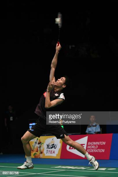 Kazumasa Sakai of Japan competes against Sony Dwi Kuncoro of Indonesia during Mens single qualification round match of the BCA Indonesia Open Super...