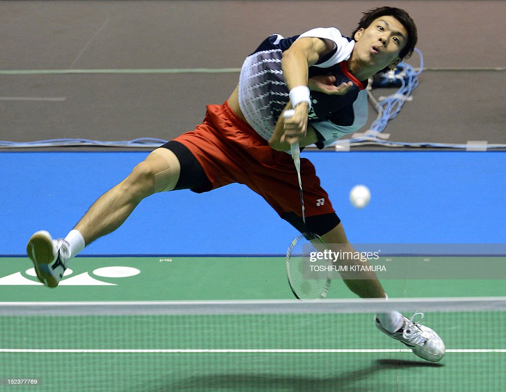 Kazumasa Sakai of Japan hits a return against Wong Wing Ki of Hong