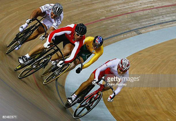 Kazunari Watanabe of Japan competes in the Men's Sprint Race for 9th12th Places in the track cycling event at the Laoshan Velodrome on Day 11 of the...