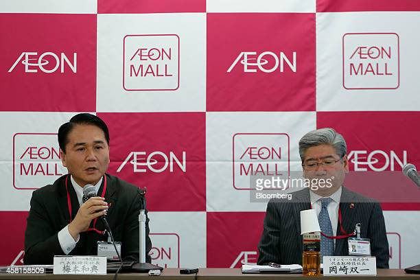 Kazunori Umemoto president of Aeon Retail Co left speaks as Soichi Okazaki president and chief executive officer of Aeon Mall Co listens during a...