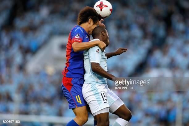 Kazunori Yoshimoto of FC Tokyo and Adailton of Jubilo Iwata compete for the ball during the JLeague J1 match between Jubilo Iwata and FC Tokyo at...