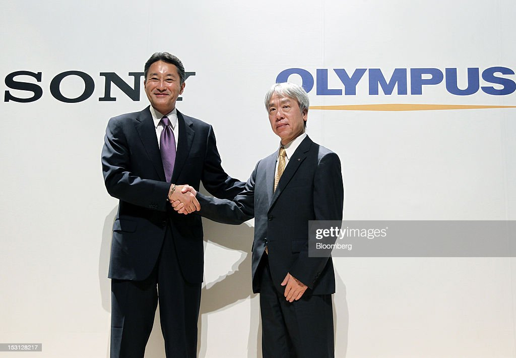 Kazuo Hirai, president and chief executive officer of Sony Corp., left, shakes hands with Hiroyuki Sasa, president and chief executive officer of Olympus Corp., during a joint news conference in Tokyo, Japan, on Monday, Oct. 1, 2012. Sony Corp., seeking ways to revive growth after four years of losses, will invest 50 billion yen ($645 million) in Olympus Corp., the world's biggest maker of endoscopes, according to finance ministry filings. Photographer: Koichi Kamoshida/Bloomberg via Getty Images