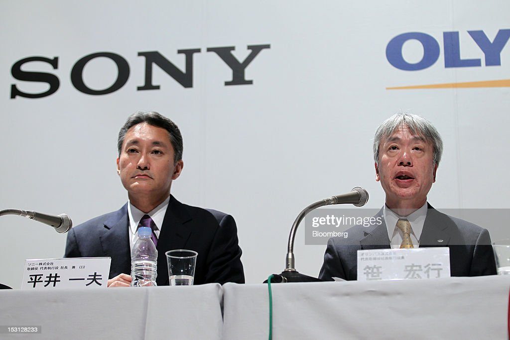 Kazuo Hirai, president and chief executive officer of Sony Corp., left, listens as Hiroyuki Sasa, president and chief executive officer of Olympus Corp., speaks during a joint news conference in Tokyo, Japan, on Monday, Oct. 1, 2012. Sony Corp., seeking ways to revive growth after four years of losses, will invest 50 billion yen ($645 million) in Olympus Corp., the world's biggest maker of endoscopes, according to finance ministry filings. Photographer: Koichi Kamoshida/Bloomberg via Getty Images