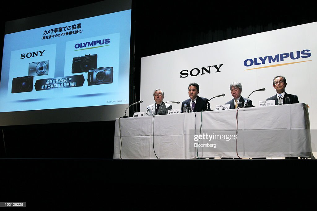 Kazuo Hirai, president and chief executive officer of Sony Corp., second left, and Hiroyuki Sasa, president and chief executive officer of Olympus Corp., second right, during a joint news conference in Tokyo, Japan, on Monday, Oct. 1, 2012. Sony Corp., seeking ways to revive growth after four years of losses, will invest 50 billion yen ($645 million) in Olympus Corp., the world's biggest maker of endoscopes, according to finance ministry filings. Photographer: Koichi Kamoshida/Bloomberg via Getty Images