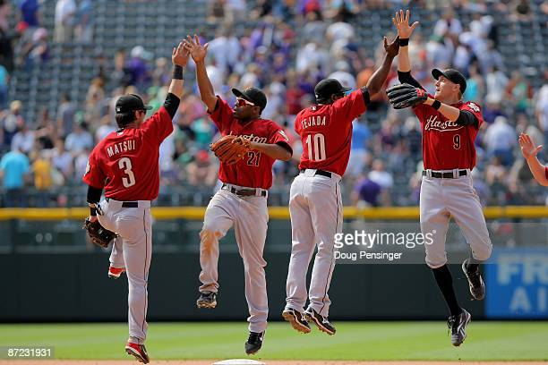 Kazuo Matsui Michael Bourn Miguel Tejada and Hunter Pence of the Houston Astros celebrate after defeating the Colorado Rockies during MLB action at...