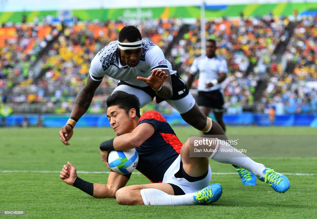 Kazushi Hano of Japan dives over for a try during the Men's Rugby Sevens semi final match between Fiji and Japan on day six of the Rio 2016 Olympic Games at Deodoro Stadium on August 11, 2016 in Rio de Janeiro, Brazil.