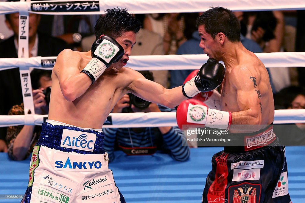 <a gi-track='captionPersonalityLinkClicked' href=/galleries/search?phrase=Kazuto+Ioka&family=editorial&specificpeople=7488576 ng-click='$event.stopPropagation()'>Kazuto Ioka</a>(L) of Japan and Juan Carlos Revecoof Argentina exchange punches during the WBA World Flyweight Title Bout at the Osaka Prefectural Gymnasium on April 22, 2015 in Osaka, Japan.