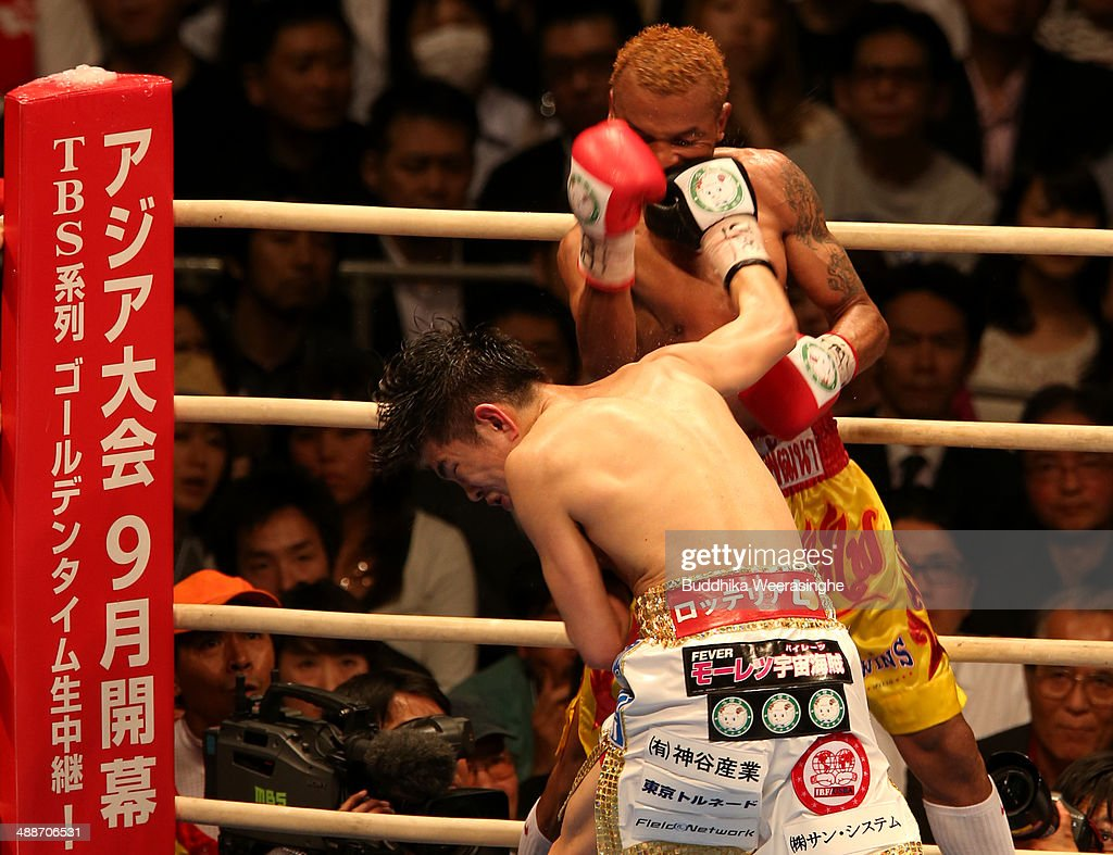 <a gi-track='captionPersonalityLinkClicked' href=/galleries/search?phrase=Kazuto+Ioka&family=editorial&specificpeople=7488576 ng-click='$event.stopPropagation()'>Kazuto Ioka</a> (front) of Japan exchanges punches with <a gi-track='captionPersonalityLinkClicked' href=/galleries/search?phrase=Amnat+Ruenroeng&family=editorial&specificpeople=4607245 ng-click='$event.stopPropagation()'>Amnat Ruenroeng</a> of Thailand during the IBF minimumweight title bout between <a gi-track='captionPersonalityLinkClicked' href=/galleries/search?phrase=Kazuto+Ioka&family=editorial&specificpeople=7488576 ng-click='$event.stopPropagation()'>Kazuto Ioka</a> of Japan and <a gi-track='captionPersonalityLinkClicked' href=/galleries/search?phrase=Amnat+Ruenroeng&family=editorial&specificpeople=4607245 ng-click='$event.stopPropagation()'>Amnat Ruenroeng</a> of Thailand at the Bodymaker Colosseum on May 7, 2014 in Osaka, Japan.