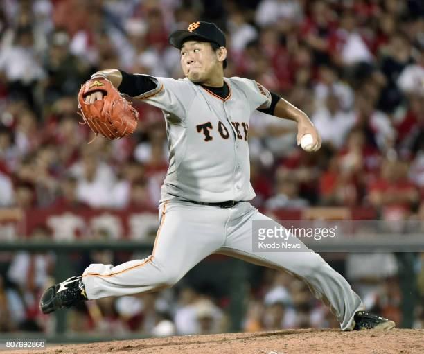 Kazuto Taguchi of the Yomiuri Giants pitches against the Hiroshima Carp at Mazda Stadium in Hiroshima on July 4 2017 Taguchi went seven innings and...