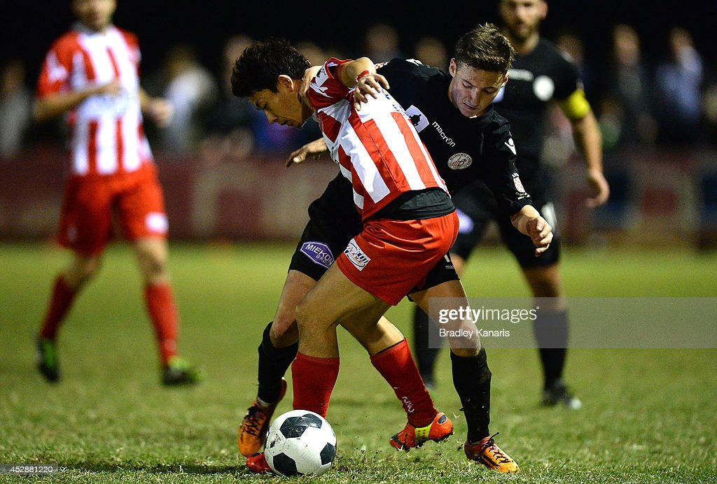 Kazuya Ito of Olympic and Jordan O'Doherty of the Knights challenge for the ball during the FFA Cup match between Olympic FC and Melbourne Knights at Goodwin Park on July 29, 2014 in Brisbane, Australia.