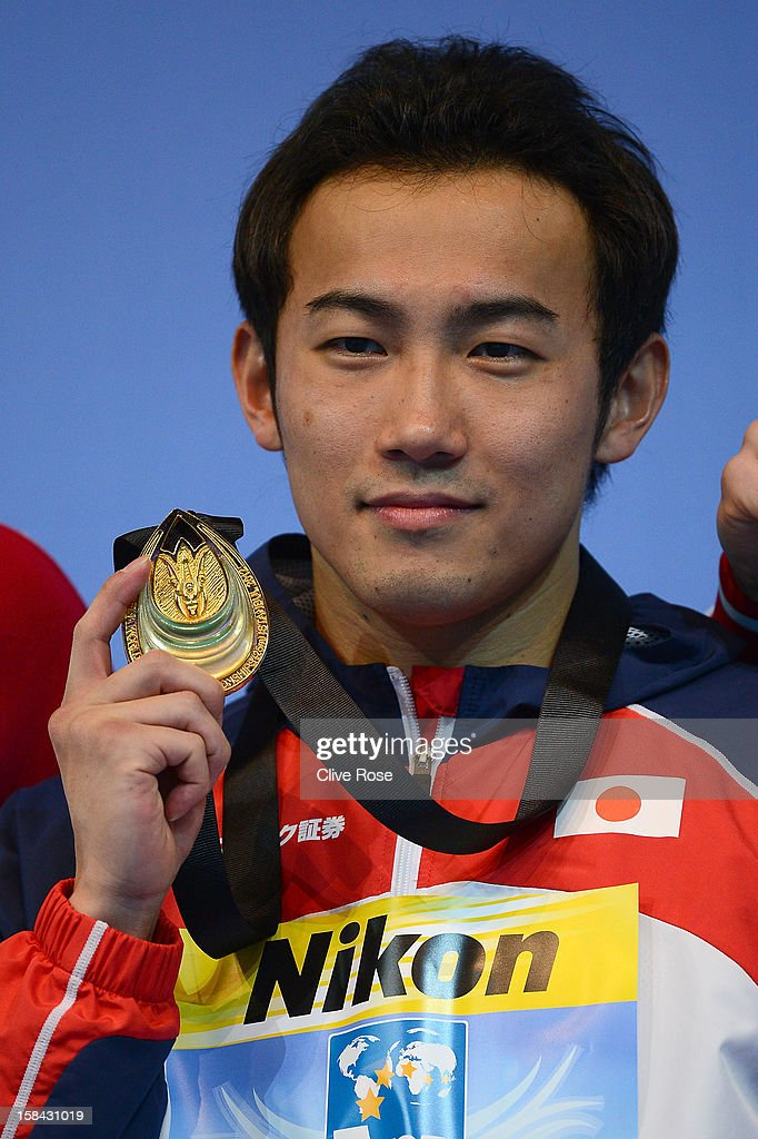 Kazuya Kaneda of Japan poses on the podium with his Gold medal after winning the Men's 200m Butterfly Final during day five of the 11th FINA Short Course World Championships at the Sinan Erdem Dome on December 16, 2012 in Istanbul, Turkey.