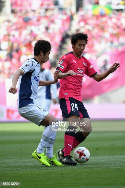 Kazuya Yamamura of Cerezo Osaka and Genta Miura of Gamba Osaka compete for the ball during the JLeague J1 match between Cerezo Osaka and Gamba Osaka...