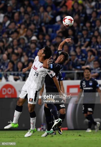 Kazuya Yamamura of Cerezo Osaka and Genta Miura of Gamba Osaka compete for the ball during the JLeague J1 match between Gamba Osaka and Cerezo Osaka...