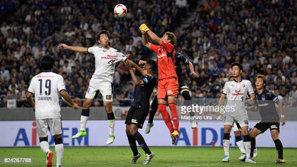 Kazuya Yamamura of Cerezo Osaka and Masaaki Higashiguchi of Gamba Osaka compete for the ball during the JLeague J1 match between Gamba Osaka and...