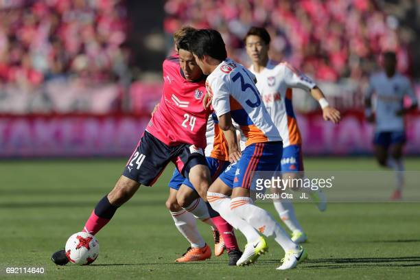 Kazuya Yamamura of Cerezo Osaka and Teruki Hara of Albirex Niigata compete for the ball during the JLeague J1 match between Cerezo Osaka and Albirex...