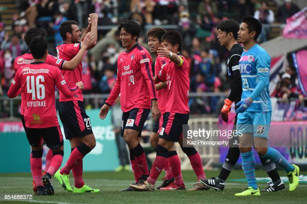 Kazuya Yamamura of Cerezo Osaka celebrates scoring the opening goal with his team mates during the JLeague J1 match between Cerezo Osaka and Sagan...