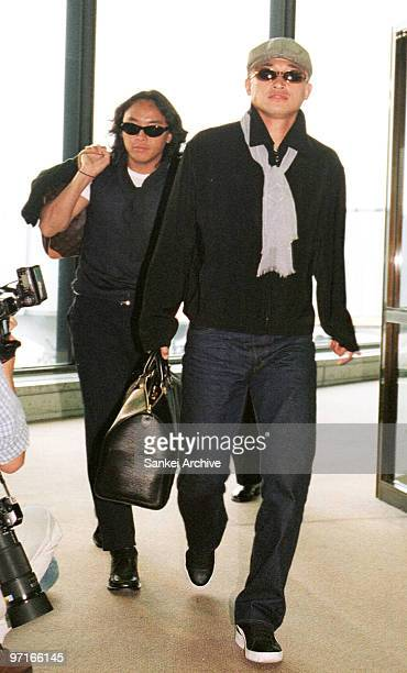 Kazuyoshi Miura and Tsuyoshi Kitazawa are seen upon arrival after being dropped from 1998 France World Cup squad at New Tokyo International Airport...