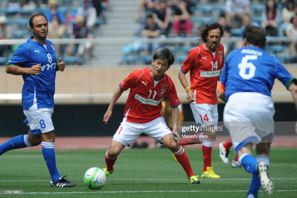 Kazuyoshi Miura #11 in action during the J.League Legend and Glorie Azzurre match at the National Stadium on June 9, 2013 in Tokyo, Japan.
