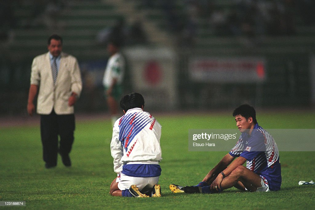 Kazuyoshi Miura of Japan is consoled by Yasutoshi Miura after the 1994 FIFA World Cup Asian Final Qualifier match between Japan and Iraq at AlAhly...