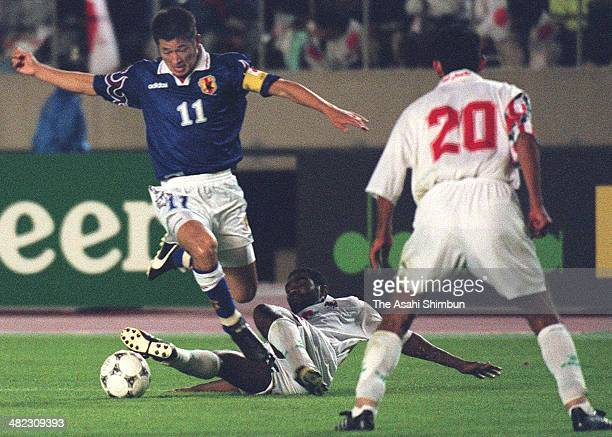 Kazuyoshi Miura of Japan is tackled by an UAE defender during the France World Cup Asian Qualifier final round match between Japan and the United...