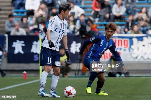Kazuyoshi Miura of Yokohama FC and Yuki Saneto of Avispa Fukuoka compete for the ball during the JLeague J1 match between Sanfrecce Hiroshima and...
