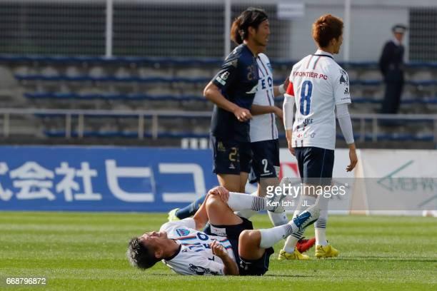 Kazuyoshi Miura of Yokohama FC lies injured during the JLeague J2 match between Machida Zelvia and Yokohama FC at Machida Athletic Stadium on April...