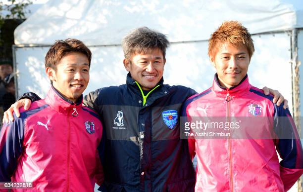 Kazuyoshi Miura of Yokohama FC poses for photographs with Hiroshi Kiyotake and Yoichiro Kakitani of Cerezo Osaka after their training match on...