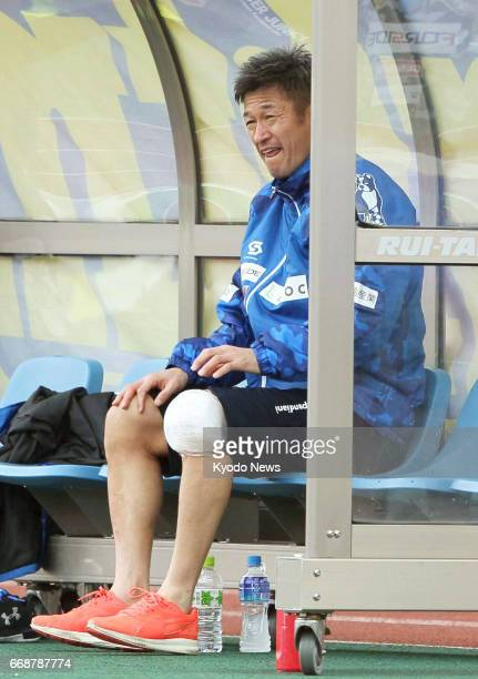 Kazuyoshi Miura sits on the bench in the second half of Yokohama FC's 10 loss away to Machida Zelvia in the JLeague second division on April 15 2017...