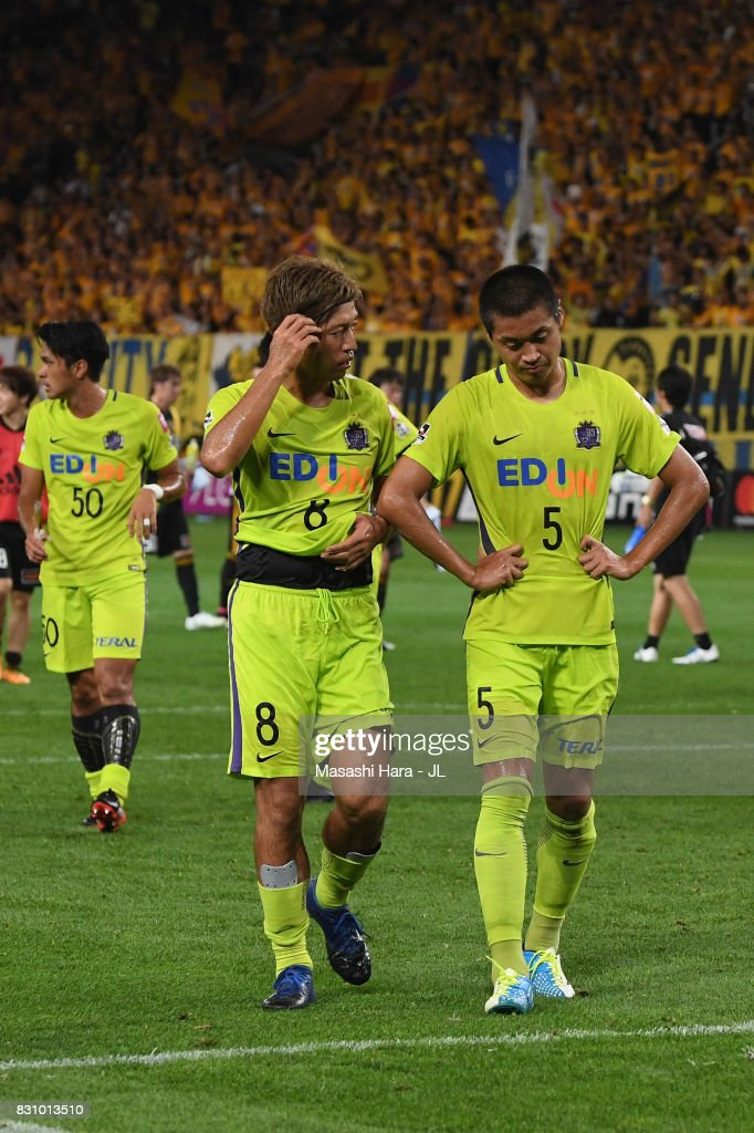 Kazuyuki Morisaki and Kazuhiko Chiba of Sanfrecce Hiroshima show dejeciton after their 0-1 defeat in the J.League J1 match between Vegalta Sendai and Sanfrecce Hiroshima at Yurtex Stadium Sendai on August 13, 2017 in Sendai, Miyagi, Japan.