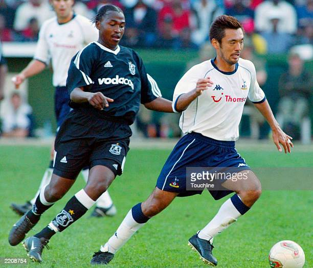 Kazuyuki Toda of Spurs and Lesley Manyathela of the Orlando Pirates during the 2010 World Cup bid Club Challenge between the Orlando Pirates v...
