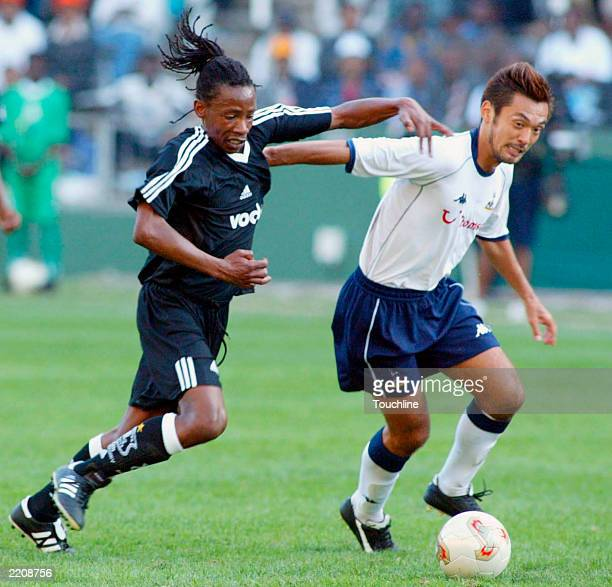 Kazuyuki Toda of Spurs hands off Sailor Tshabala of the Orlando Pirates during the 2010 World Cup bid Club Challenge between the Orlando Pirates v...