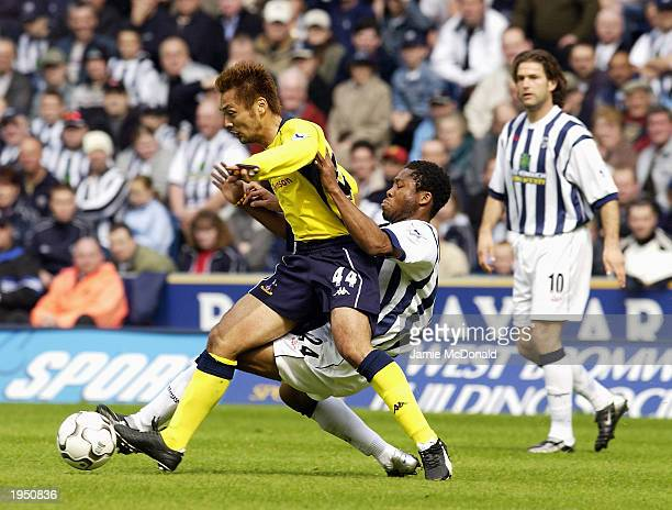 Kazuyuki Toda of Tottenham Hotspur is challenged by Ifeanyi Udeze of West Bromwich Albion during the FA Barclaycard Premiership match between West...